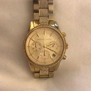 Semi used Gold Michael Kors women's watch